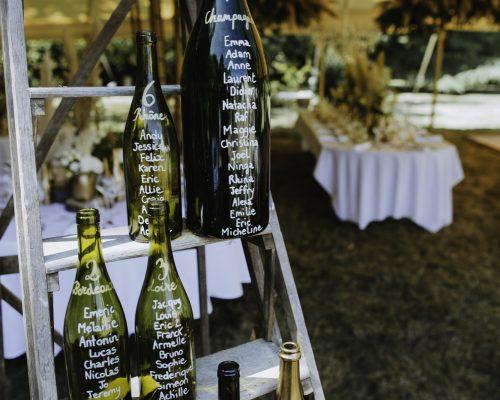 Plan de table bouteilles de vin mariage boheme decoration studio aloki